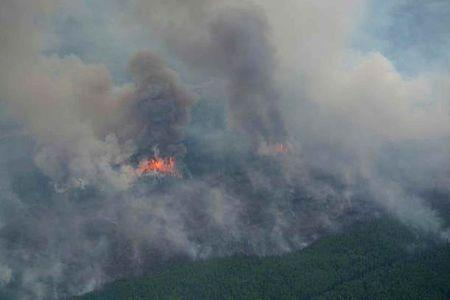 Smoke rises from a wildfire north of Cold Lake, Alberta