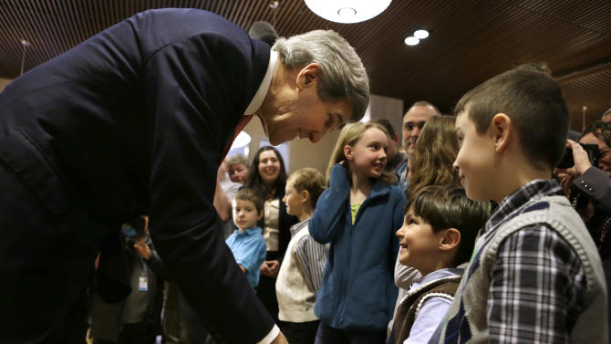 U.S. Secretary of State John Kerry shakes hands with the children of U.S. Embassy staff at the Embassy in Berlin on Tuesday, Feb. 26, 2013. Berlin is the second stop in Kerry's first trip overseas as secretary. (AP Photo/Jacquelyn Martin, Pool)
