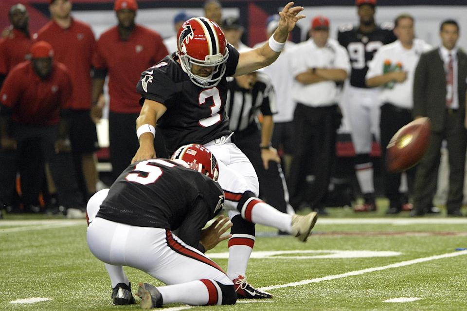 Atlanta Falcons kicker Matt Bryant (3) makes the winning field goal as Matt Bosher (5) holds during the second half of an NFL football game against the Carolina Panthers, Sunday, Sept. 30, 2012, in Atlanta. Atlanta won 30-28. (AP Photo/Rich Addicks)
