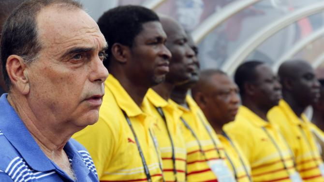 Ghana's head coach Avram Grant of Israel stands with his players as they listen to their national anthem before their quarter-final soccer match of the 2015 African Cup of Nations against Guinea in Malabo