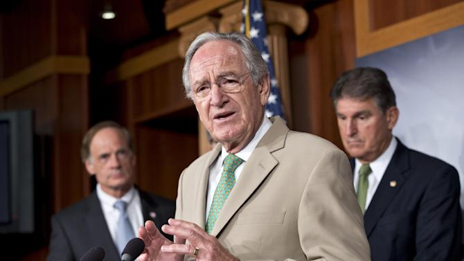 Sen. Tom Harkin, D-Iowa, chair of the Senate Education Committee, announces to reporters that a bipartisan agreement was reached on lowering rates for government student loans, at the Capitol in Washington, Thursday, July 18, 2013. At left is Sen. Tom Carper, D-Del., with Sen. Joe Manchin, D-W.V., at right. (AP Photo/J. Scott Applewhite)