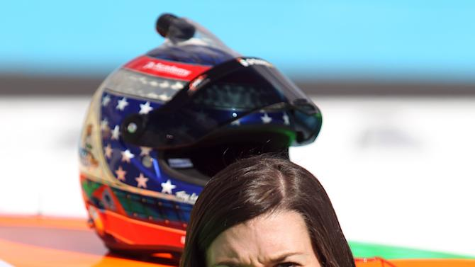 Driver Danica Patrick looks toward a competitor's time displayed after qualifying for the NASACAR Nationwide Series auto race Saturday, Nov. 10, 2012, at Phoenix International Raceway in Avondale, Ariz.(AP Photo/Paul Connors)
