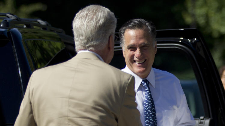 Republican presidential candidate, former Massachusetts Gov. Mitt Romney, right, greets a bystander before entering the Church of Jesus Christ of Latter-day Saints on Sunday, Aug. 19, 2012, in Wolefboro, N.H.  (AP Photo/Evan Vucci)