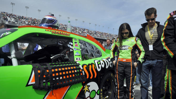 Danica Patrick, left, stands with husband Paul Hospenthal before the NASCAR Nationwide Drive4COPD 300 auto race in Daytona Beach, Fla., Saturday, Feb. 25, 2012. (AP Photo/Rainier Ehrhardt)
