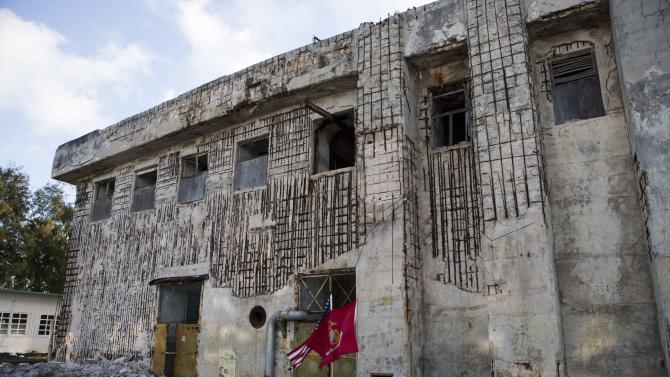 The war scarred WW II era U.S. command post is seen on Midway Atoll