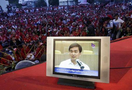 Footage of Thailand's Prime Minister Abhisit Vejjajiva negotiating with leaders of an anti-government demonstration is seen on the television at the demonstration in Bangkok