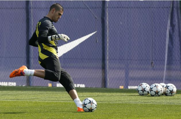 Barcelona's goalkeeper Victor Valdes kicks the ball during a training session at Ciutat Esportiva Joan Gamper in Sant Joan Despi ahead of the Champions League last 16 second leg against Manchester
