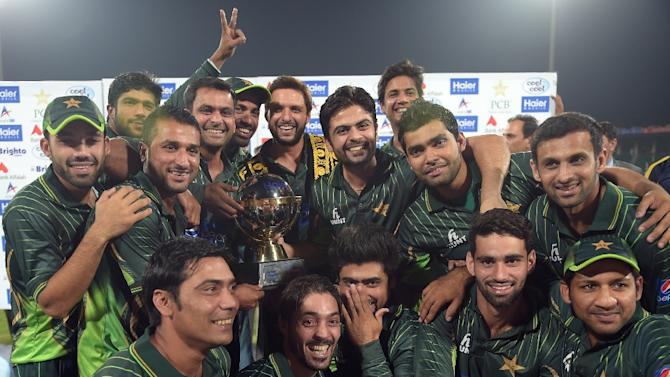 Pakistani cricketers pose with the winning trophy after defeating Zimbabwe at the end of the second and final International T20 cricket match between Pakistan and Zimbabwe at the Gaddafi Cricket Stadium in Lahore on May 24, 2015