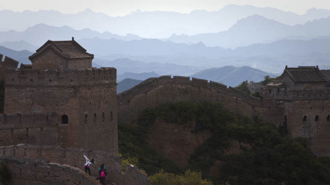 A tourist poses for photos on the Great Wall of China in Luanping, in northern China's Hebei province, Sunday, Sept. 18, 2011. (AP Photo/Alexander F. Yuan)