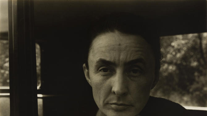In this photo provided by Crystal Bridges Museum of American Art in Bentonville, Ark., artist Georgia O'Keeffe poses in a gelatin silver photographic print for her photographer husband, Alfred Stieglitz, in 1932. The photo is part of the Fisk Collection, 50 percent of which is shared between Crystal Bridges and Fisk University in Nashville, Tenn., and will be displayed at Crystal Bridges Nov. 9 through Feb. 3, 2014. (AP Photo/Crystal Bridges Museum of American Art Fisk Collection, Alfred Stieglitz)