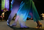 Couples dance during the final competititon in the Tango Salon category on August 27, 2012 at the World Championship of Tango in Buenos Aires. UNESCO added Tango to its world heritage list of intangible treasures in 2009, and a half million people, including some 70,000 foreigners, attended this year&#39;s competition, according to organizers