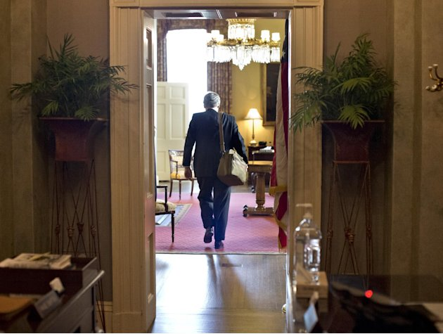 Senate Minority Leader Mitch McConnell of Kentucky, arrives at his office in the Capitol as he and Senate Majority Leader Harry Reid of Neveda try to negotiate a legislative solution to avoid the so-c
