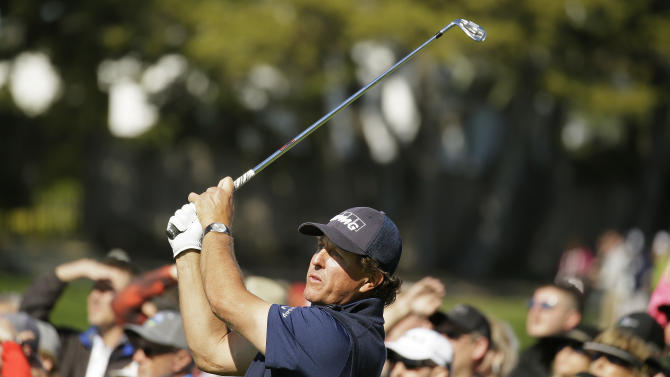 Phil Mickelson follows his shot from the 17th tee of the Pebble Beach Golf Links during the third round of the AT&T Pebble Beach National Pro-Am golf tournament Saturday, Feb. 13, 2016, in Pebble Beach, Calif. (AP Photo/Eric Risberg)