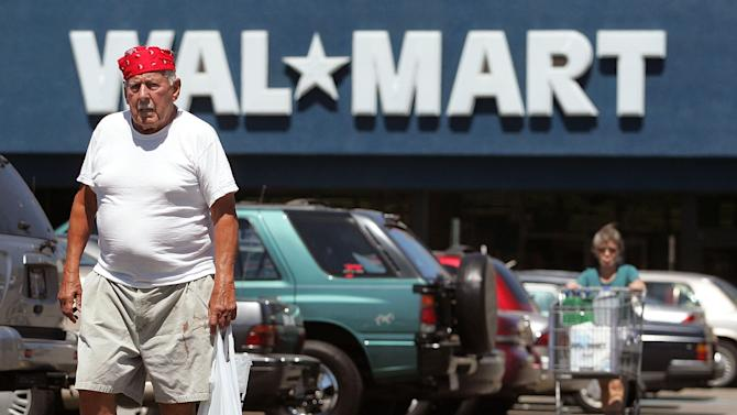 Two shoppers walk in the parking lot outside a Wal-Mart store on August 15, 2006 in Mount Prospect, Illinois