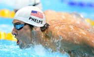 US swimmer Michael Phelps competes in the men&#39;s 200m butterfly heats swimming event at the London 2012 Olympic Games at the Olympic Park in London on July 30