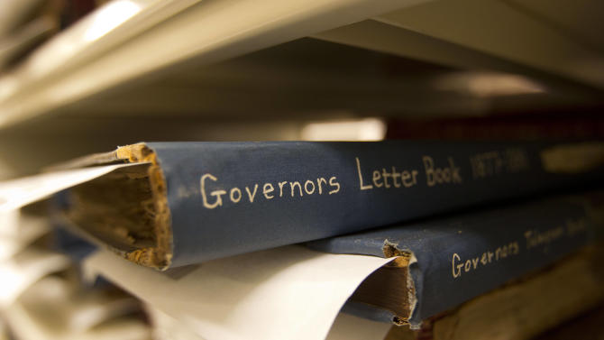In this Wednesday, Oct. 17, 2012 photo, bond letters are stored at the Georgia State Archives in Morrow, Ga. The Georgia State Archives will remain open to the public two days a week after an uproar over plans to limit access to appointments only for six days a month, state officials said Thursday, Oct. 18, 2012. Gov. Nathan Deal and Secretary of State Brian Kemp said $125,000 of a planned $733,000 cut in funding would be restored. (AP Photo/John Bazemore)