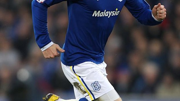 Aron Gunnarsson settled a thrilling encounter in Cardiff City&#39;s favour with the winner