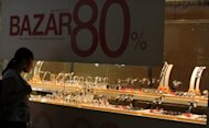 File photo shows a woman looking at jewellery and wristwatches at a shopping mall in Rio de Janeiro, Brazil, in January. The Brazilian government said it was cutting its economic growth forecast for this year from 4.5% to 3% due to the impact of the global slowdown