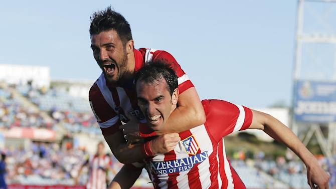 Liverpool, Atletico Madrid win and are in command