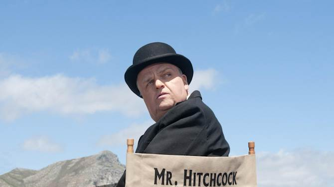 "This image released by HBO shows Toby Jones, portraying Alfred Hitchcock in a scene from the film ""The Girl.""   ""The Girl"" was nominated for a Golden Globe for best television movie or miniseries on Thursday, Dec. 13, 2012. The 70th annual Golden Globe Awards will be held on Jan. 13.  (AP Photo/HBO, Kelly Walsh)"