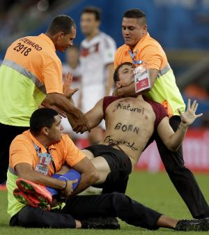 Fan on pitch stops play at World Cup final