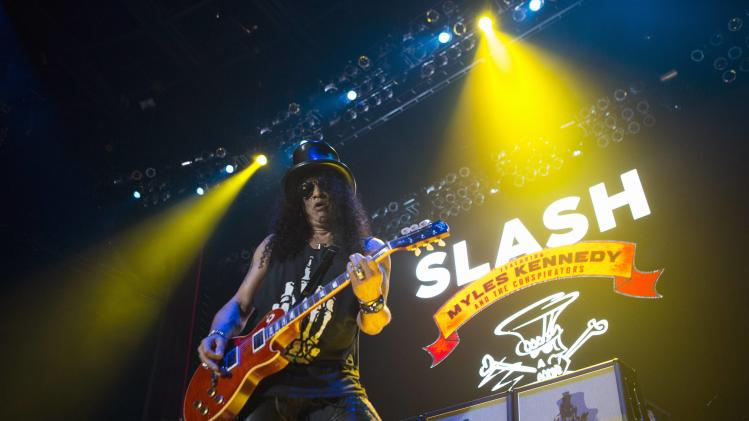 Guitarist Slash performs at The Forum in Inglewood
