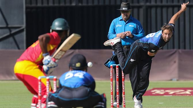 New Zealand bowler Grant Elliot plays a shot during the second game in a series of three One Day International (ODI) cricket matches between Zimbabwe and New Zealand at Harare Sports Club on August 4, 2015