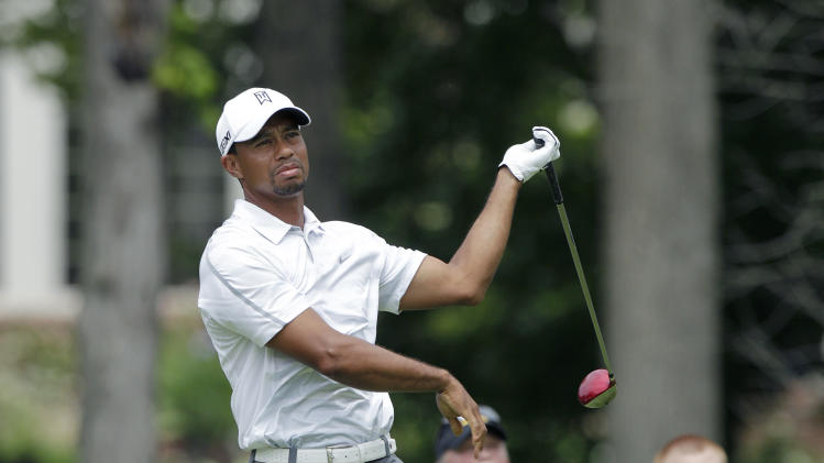 Tiger Woods reacts to hitting a bad shot on the ninth hole during the third round of the Memorial golf tournament Saturday, June 1, 2013, in Dublin, Ohio. (AP Photo/Jay LaPrete)