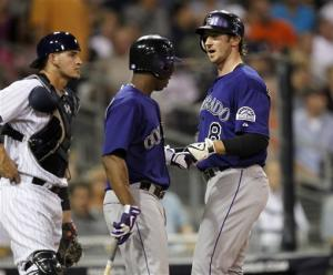 Rockies use big first inning to beat Padres 7-4