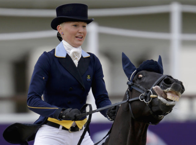 Malin Petersen, of Sweden, and her horse Sofarsogood, exit the ring after competing in the equestrian eventing dressage phase at the 2012 Summer Olympics, Sunday, July 29, 2012, in London. (AP Photo/David Goldman)