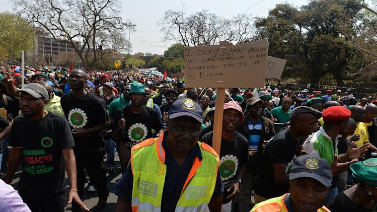 South African miners march in Pretoria, on September 12, 2013 to protest at a lack of state funding for survivors of shootings at the Marikana mine, where 44 people died