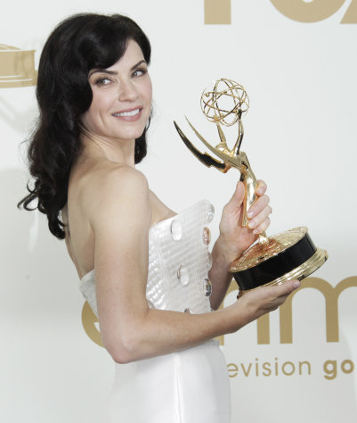 "FILE - In this Sept. 18, 2011 file photo, ""The Good Wife"" cast member Julianna Margulies poses with the Emmy for best lead actress in a drama series backstage at the 63rd Primetime Emmy Awards in Los Angeles. Margulies is one of many successful actresses over 40 working in Hollywood. (AP Photo/Jae Hong, file)"