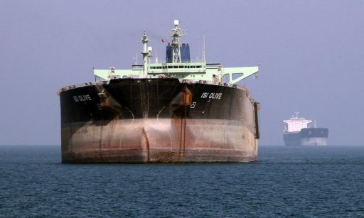 File photo shows an oil tanker off the port of Bandar Abbas, southern Iran, on July 2. Iran is expanding its insurance on its fleet of 47 oil tankers through a multi-billion-dollar line of credit as it seeks to get around EU sanctions crimping its crude exports, reports said on Saturday