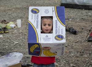 A child plays with a cardboard box at the northern …