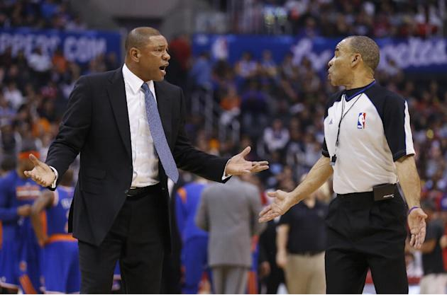 Los Angeles Clippers coach Doc Rivers talks with official Dan Crawford after Chris Paul was called for a technical foul during the first half of an NBA basketball game against the New York Knicks in L