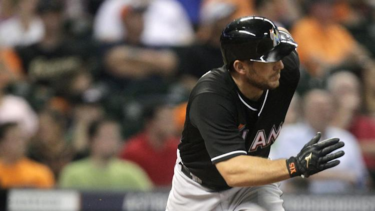 Miami Marlins' Jeff Mathis hits a double to left field that scored Jarrod Saltalamacchia and Adeiny Hechavarria during the seventh inning of a baseball game against the Houston Astros, Friday, July 25, 2014, in Houston. (AP Photo/Patric Schneider)