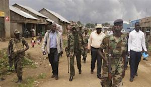 Congolese leaders of the M23 rebels are escorted in Bunagana in eastern DRC
