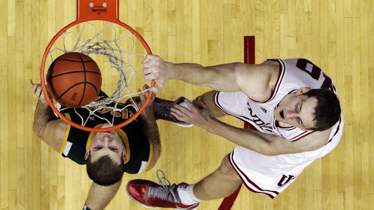 Indiana's Cody Zeller, right, dunks against North Dakota State's Taylor Braun during the first half of an NCAA college basketball game, Monday, Nov. 12, 2012, in Bloomington, Ind. (AP Photo/Darron Cummings)
