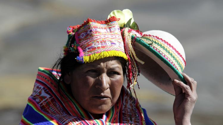 An Aymara woman is seen during a ceremony to bless Bud Lane and his family at La Cumbre, on the outskirts of La Paz