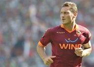 Roma are set to be without influential playmaker Francesco Totti, pictured on September 16, for Sunday&#39;s Serie A game in Cagliari, which will be played in an empty stadium