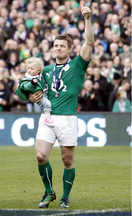 Ireland's Brian O'Driscoll and daughter Sadie leave the pitch after he played his last home game during during their Six Nations Rugby Union match against Italy at the Aviva Stadium, Dublin, I