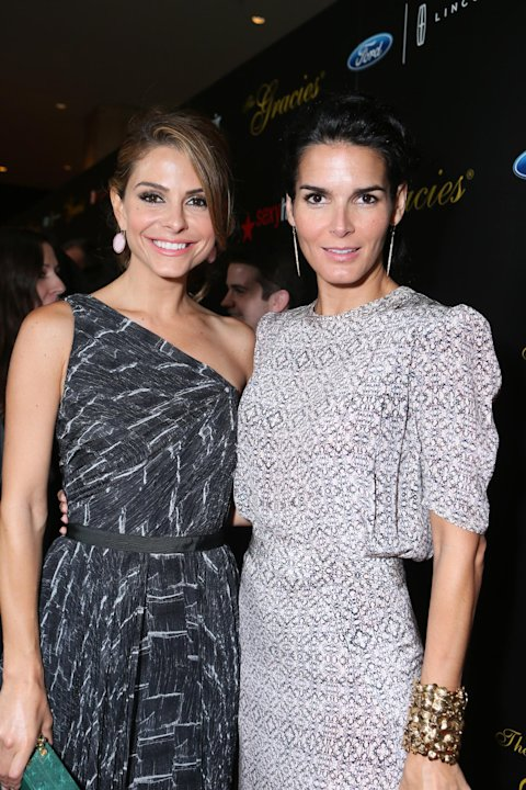 Maria Menounos, left, and Angie Harmon arrive at Sexy Hair Celebrates The Gracies Presented By The Alliance For Women In Media Foundation, on Tuesday, May, 21, 2013 in Beverly Hills, Calif. (Photo by