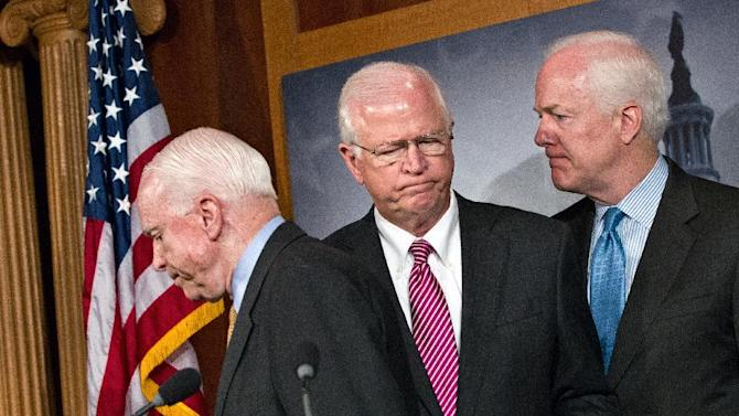 "FILE - This June 26, 2012 file photo shows, from left, Sen. John McCain, R-Ariz., Sen. Saxby Chambliss, R-Ga., vice chair of the Senate Intelligence Committee, and Sen. John Cornyn, R-Texas, during a news conference on Capitol Hill in Washington. Chambliss announced Friday, Jan. 25, 2013, he will not seek a third term next year, saying ""this is about frustration"" with Washington gridlock that he doesn't see changing in a divided government. (AP Photo/J. Scott Applewhite, File)"