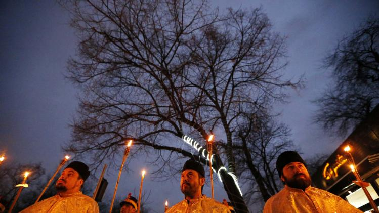 Orthodox priests participate in a religious procession to mark the first Saturday and Sunday of Lent in Bucharest