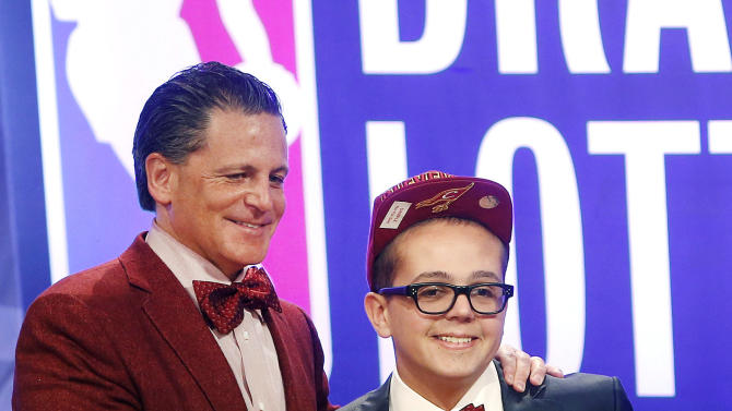Cleveland Cavaliers owner Dan Gilbert poses with his son Nick Gilbert after winning the NBA basketball draft lottery, Tuesday, May 21, 2013 in New York. (AP Photo/Jason DeCrow)