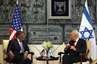 Israeli President Shimon Peres (R) meets with US Defence secretary Leon Panetta at the presidential compound in Jerusalem. Peres said Iran is &quot;the only country that is both imperialist and threatening to destroy another country.&quot;