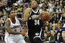 Paul Pierce (R), then of the Brooklyn Nets, dribbles past Louis Williams of the Atlanta Hawks during the NBA Global Games London 2014 match at the O2 Arena in London on January 16, 2014