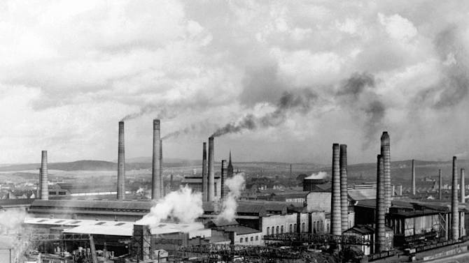 FILE - In this Aug. 29, 1938 file photo, smoke rises from smokestacks at Skoda's main foundry in Pilsen, Czechoslovakia. A new study looking at 11,000 years of climate temperatures shows the world in the middle of a dramatic U-turn, lurching from near-record cooling to a heat spike. It shows how the globe for several thousands of years was cooling until an unprecedented reversal in the 20th century, which scientists say is further evidence that global warming isn't natural but man-made since the start of the Industrial Revolution. The research was released Thursday, March 7, 2013 in the journal Science. (AP Photo)