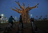 South Africans light up a Baobab tree by riding bikes in Durban in 2011 as part of a renewable energies display on the beach front during the UN Climate Change Conference (COP17). Climate change caused by global warming is freezing the world economy, a report commissioned by 20 of the world&#39;s most vulnerable countries said Wednesday
