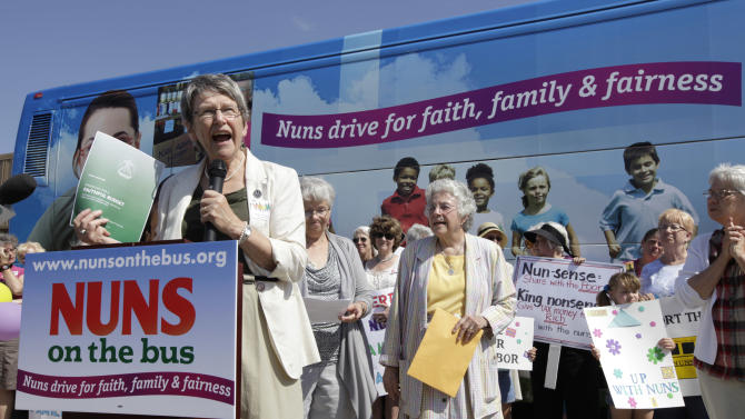 Sister Simone Campbell, executive director of Network, speaks during a stop on the first day of a 9-state Nuns on the Bus tour, Monday, June 18, 2012, in Ames, Iowa. The group of Roman Catholic nuns say they're not opposing any particular candidate but that their fight is with a Republican proposed federal budget they say hurts the poor and needy. (AP Photo/Charlie Neibergall)